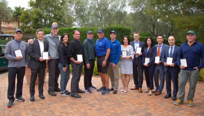 group of winners at charity golf tournament in orange county